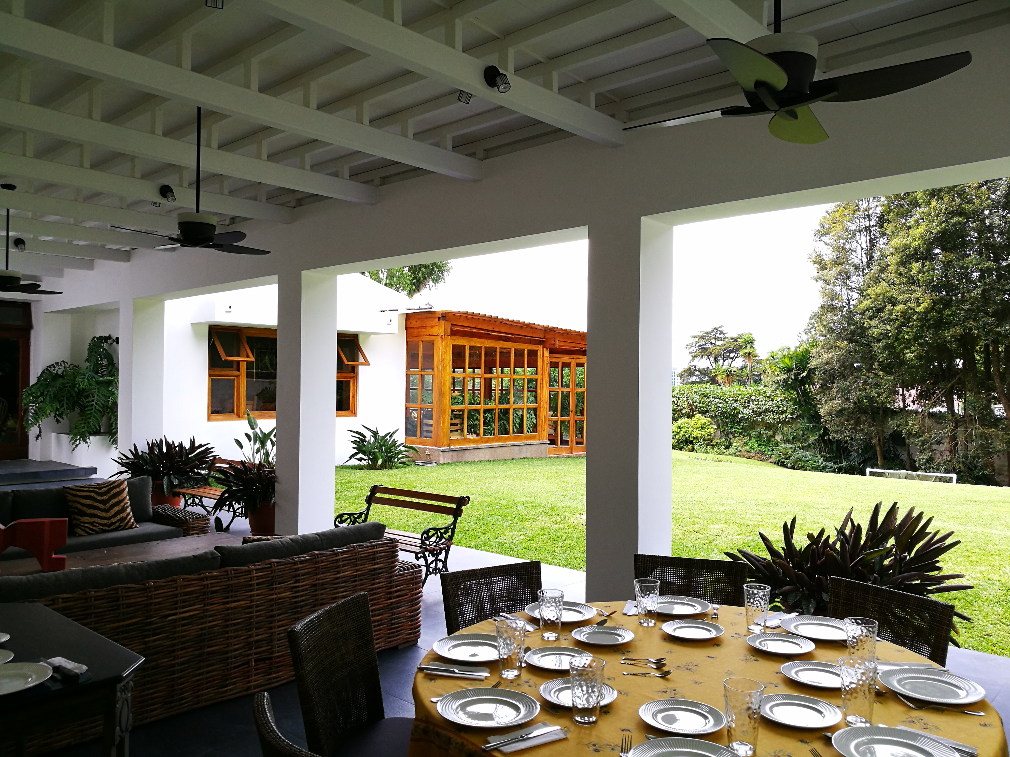 Refreshing a home with innovative additions, garage and pergola